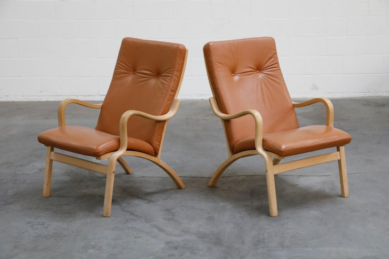 Scandinavian Modern Scandinavian Bentwood Leather Lounge Chairs and Ottoman, circa 1970s For Sale
