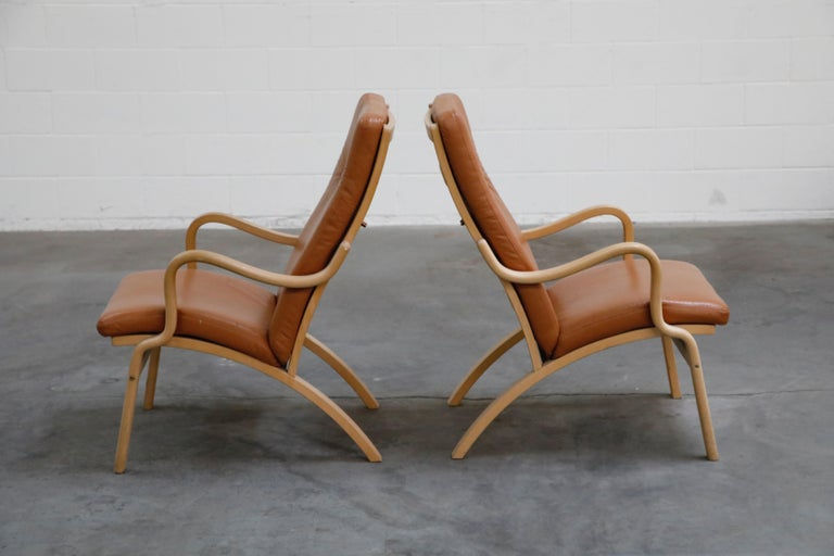 Danish Scandinavian Bentwood Leather Lounge Chairs and Ottoman, circa 1970s For Sale