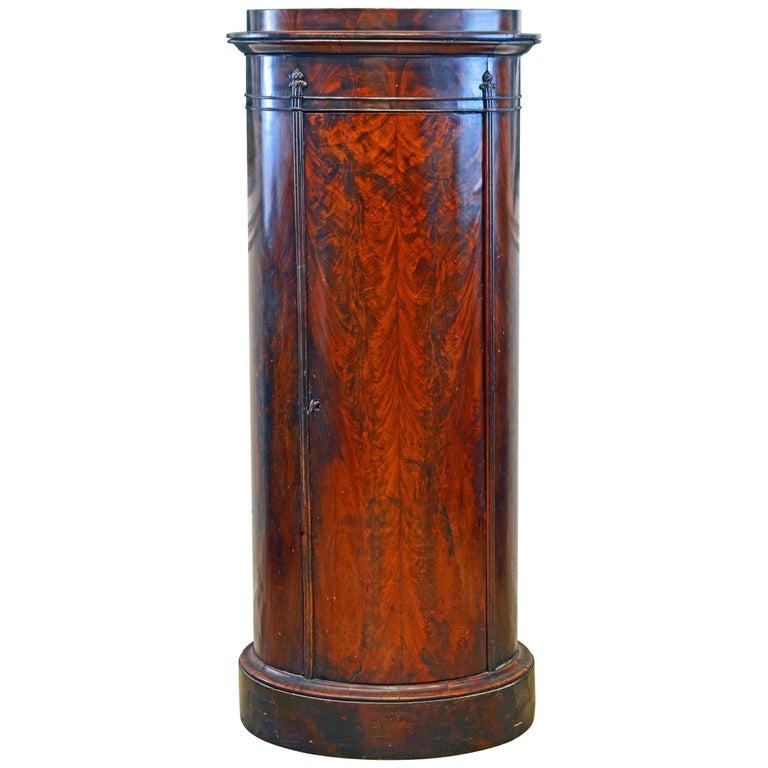 Scandinavian 19th Century Figured Flame Mahogany Oval Pedestal Cabinet