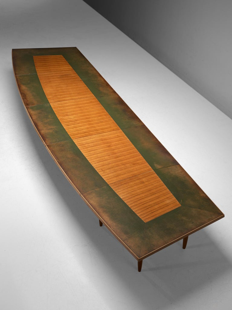 Conference table, walnut, wood and leather, Scandinavia, 1950s.  This nearly 7 metre/23 ft. long conference table is an exquisite piece from the Scandinavian Modern period. Probably custom made, the table features an unusual, yet interesting
