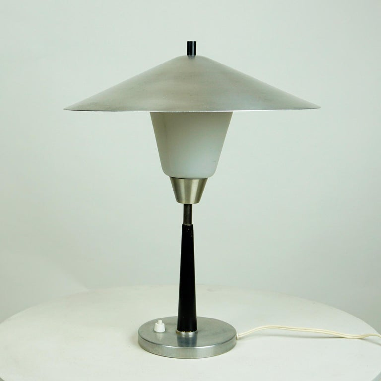 This charming rare Scandinavian table lamp has been produced by Fog and Mørup Denmark in the 1960s. It´s design is very close to Models Designed by jp Hammerborg, so this one can also be attributed to him. It features aluminum base and lampshade, a