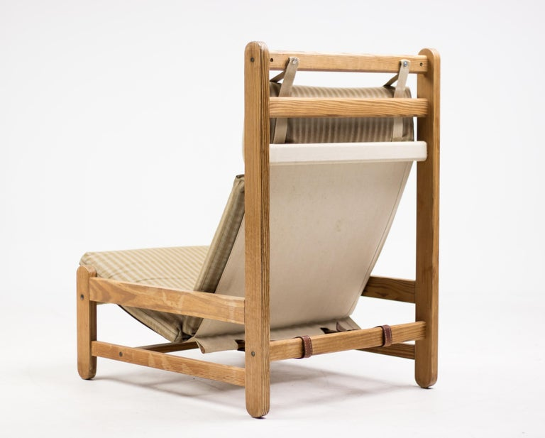 Danish lounge chair with Oregon pine frame and striped canvas sling seat. Will be disassembled for easy shipping.