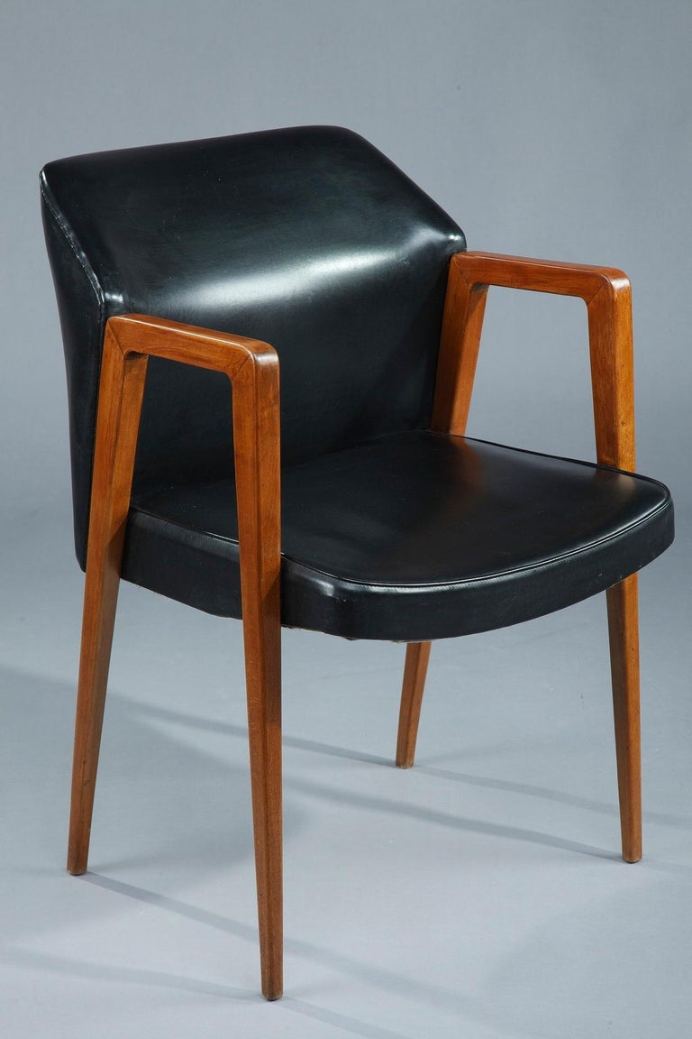 Scandinavian armchair from the 50s in rosewood, with seating and backrest in black leather imitation. This Danish office desk was designed by Arne VODDER (1926-2009). Manufacturer: Sibast.  Circa :1950 Dim: W: 20,5 in - D: 25,2in - H: 31,9in. Dim: