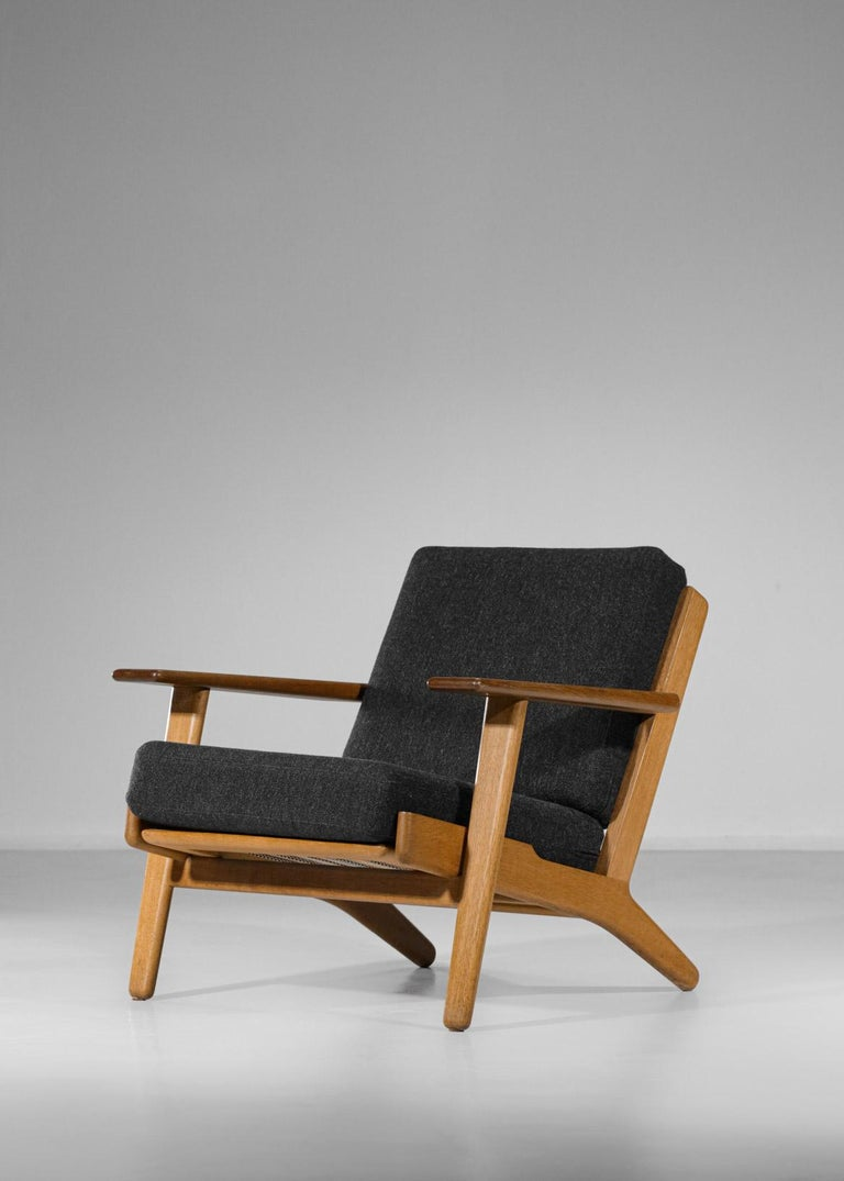 Scandinavian armchair GE 290 by the famous designer Hans Werner from 1953 published by GETAMA. Solid oak frame with sloping legs and a backrest that slopes slightly backwards for perfect seating. Original cushions reupholstered. Excellent vintage