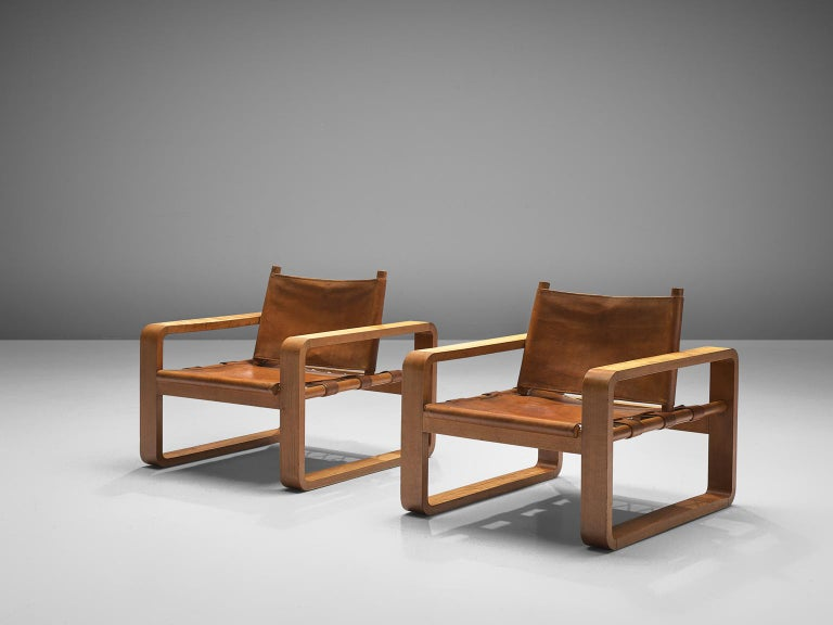 Set of two Scandinavian lounge chairs, cognac leather, beech and rope, Scandinavia, 1960s.
