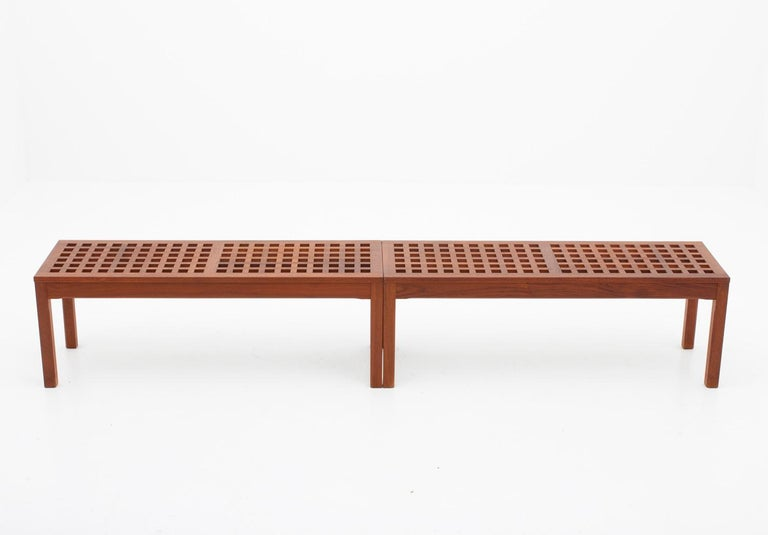 Pair of Scandinavian benches in Teak by John Vedel-Rieper for Källemo (Sweden), 1960s. Beautiful benches made of solid teak, creating a cross pattern. Very all-round furniture that could be used as, for example, coffee table, plant stand, or media