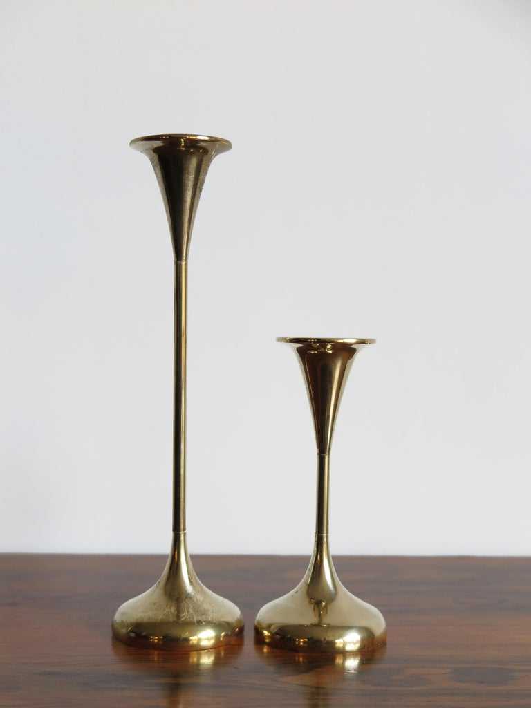 Set of two solid brass Scandinavian Mid-Century Modern design candle holders, Denmark 1950 c.a. Please note that the items are original of the period and this shows normal signs of age and use.