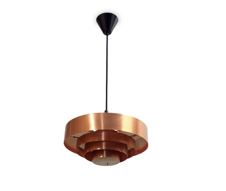 Wonderful ceiling lamp in massive copper. Designed by Jo Hammerborg and made in Denmark by Fog & Mørup from 1957. The lamp is fully working and in excellent vintage condition.