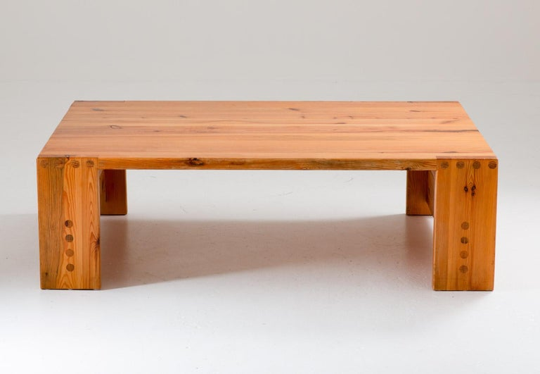 Rare coffee table in pine by Sven Larsson, Sweden, circa 1970.  This table is a great example of the robust pine furniture era that grew popular in Sweden in the late 1960s. The table is made of thick solid pine with beautiful