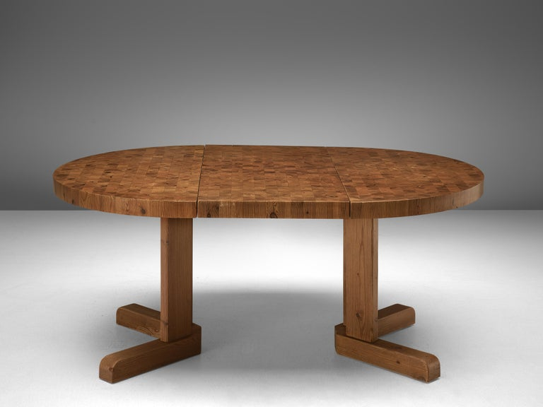 Round dining table, solid pinewood, Denmark, 1960s.  This Scandinavian Modern table features a top executed with pine end-grain wood, which shows a natural pattern. The sturdy tabletop can be extended with an additional leaf, to form an oval top