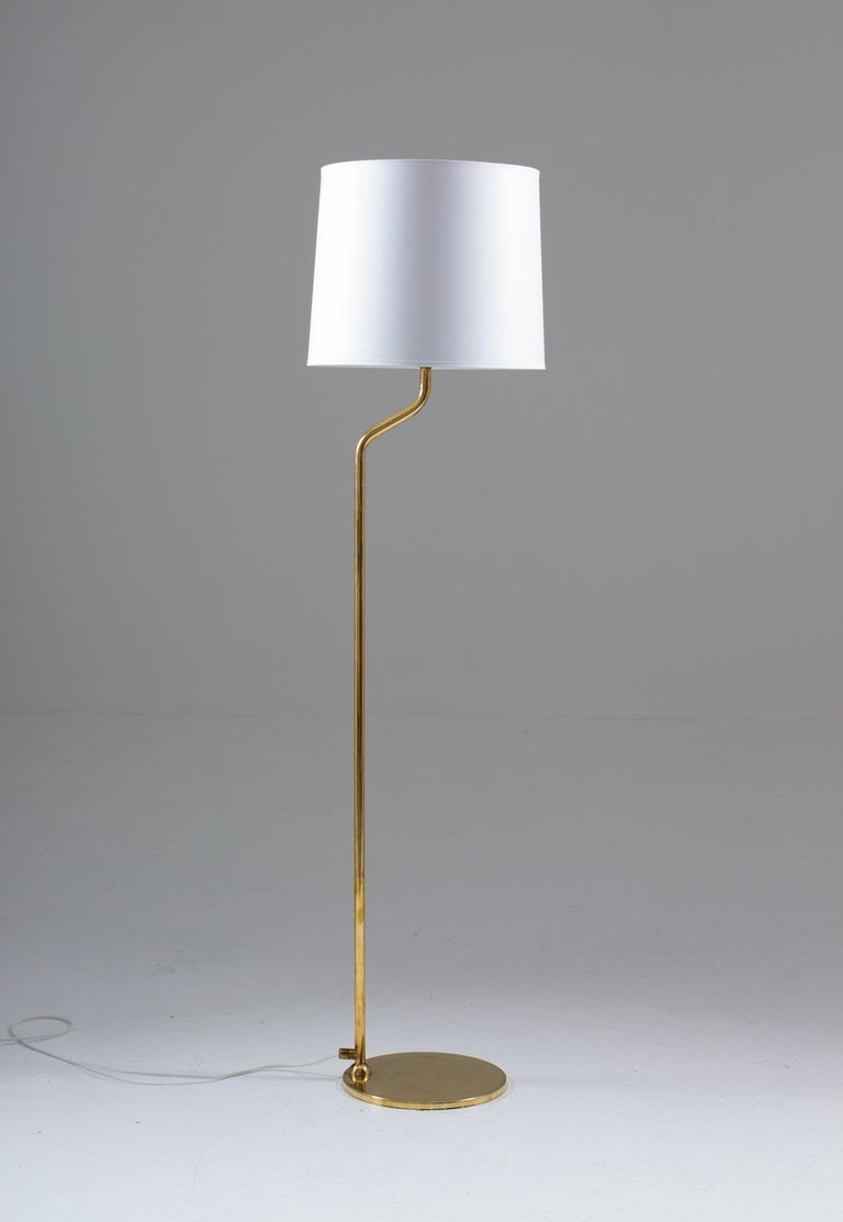 Pair of Scandinavian floor lamps in brass by ÖIA, Sweden, 1970s These lamps are made of solid brass with beautiful details. Delivered with new shades, hand-made in Sweden. Measures: Height without shades 110cm.  Condition: Very good condition
