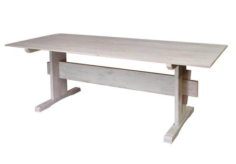 This design was inspired by an 18th century Swedish county table. The top is made of old floor boards that were finished in a traditional Scandinavian lye and chalk finish The trestle base is made of pine and poplar and has been painted using a red