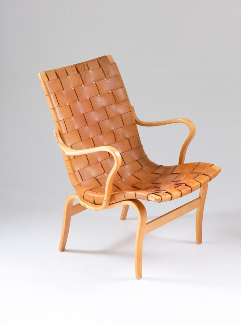"Gorgeous ""Eva"" lounge chair by Bruno Mathsson, with a wreathed leather seat on a beech bentwood frame. Perfect patinated naturally coloured leather. Manufactured in 1969 by Firma Karl Mathsson, Sweden.