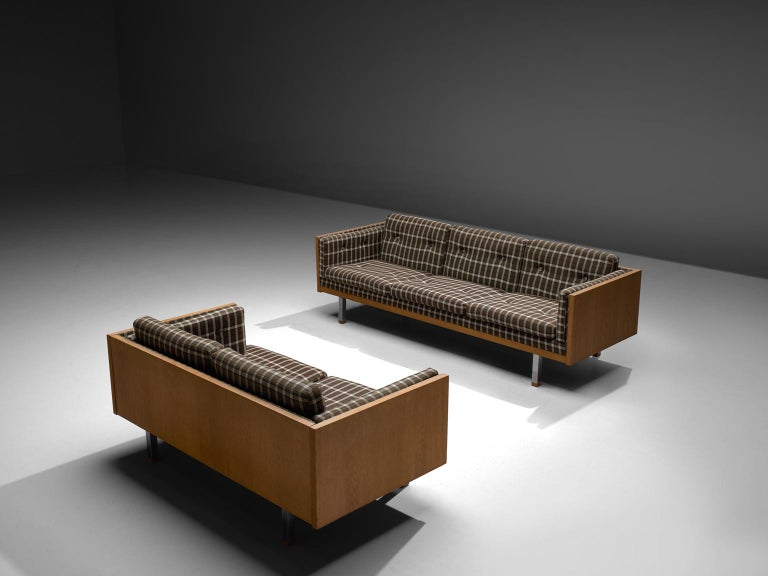 Jydsk Mobelvaerk, three and two-seat sofa, in oak, metal and fabric, Denmark, 1960s.  Scandinavian living room set, a two and three-seat sofa. The frame consist of oak with cubic metal legs, which provide an open look to the quite solid seating of