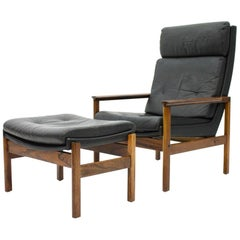 Scandinavian Lounge Chair with Stool in Wood and Black Leather, 1960s