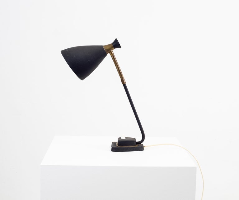 Decorative and modern table lamp in steel with a black powder coating. Most likely designed and made in Norway from circa 1950s second half. The lamp is fully working and in good vintage condition.