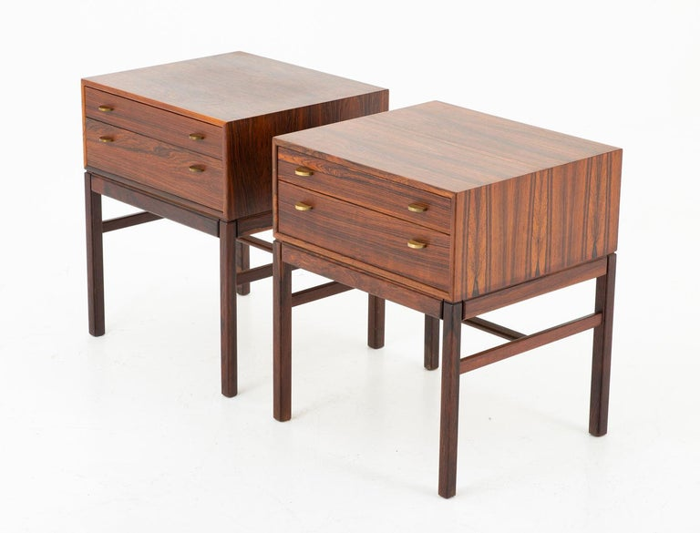 A pair of bedside tables in rosewood with brass details, model Casino by Gunnar Myrstrand and Sven Engström for Tingströms, Sweden, 1960s.  This was not originally a pair and they differ slightly. One of the tables has one big drawer instead of two