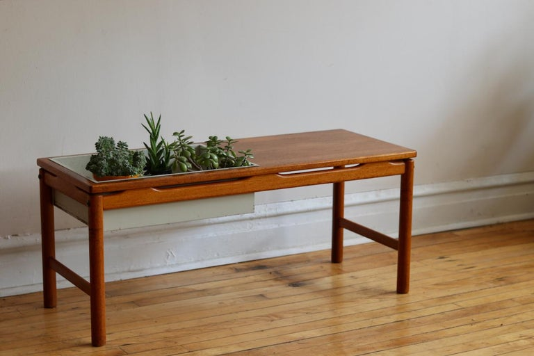Midcentury Danish modern coffee table and planter.