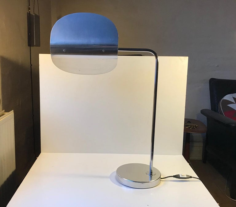 Scanlite is name of this large table lamp from Bergboms. It was designed in-house and manufactured in Sweden during the 1980s. The minimalist simple lines and the 360 degrees rotating folded circle shade makes it stand out.