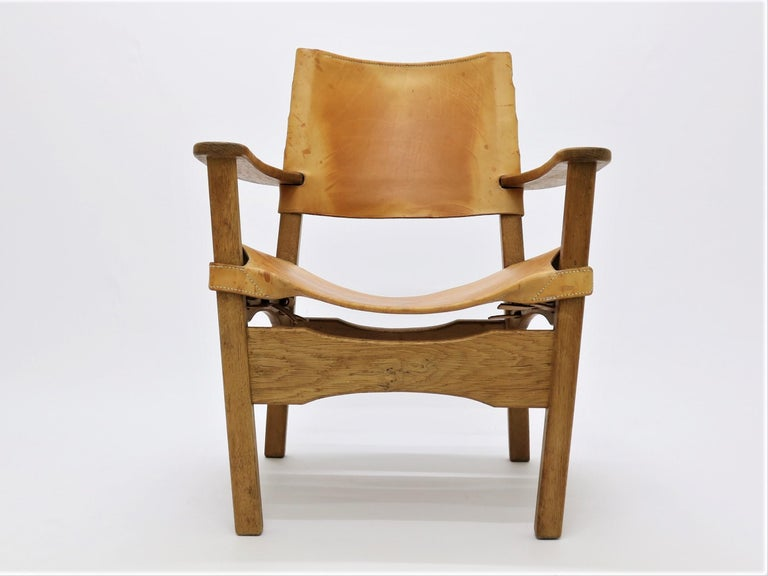 Beautifully crafted armchair by Danish cabinetmaker from the 1960s. Elegant joints and beautifully carved handcrafted elements in oak and leather makes this a great example of the skill and vision of the midcentury cabinetmakers in Denmark.