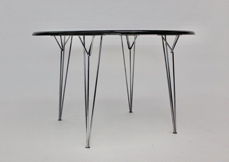 A Scandinavian Modern black vintage dining table or center table, which shows