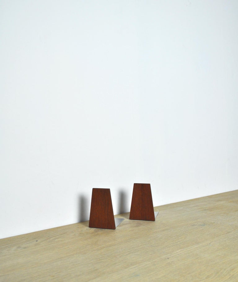 A set of two bookends in teak with steel rests, Denmark, 1960s.