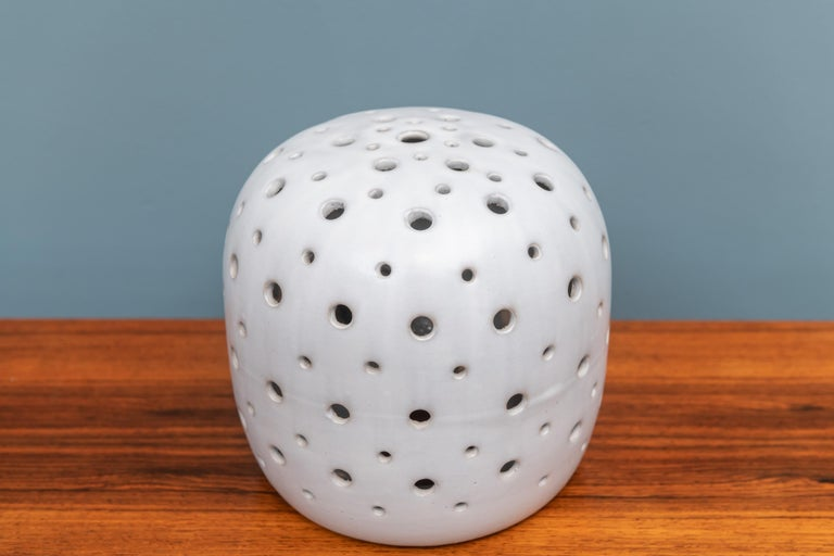 Scandinavian Modern design ceramic perforated table lamp. In very good original condition.