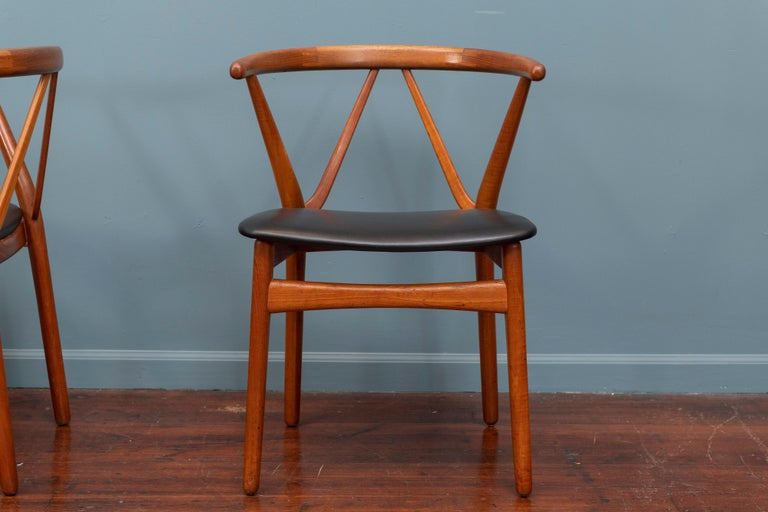 Pair of Scandinavian Modern chairs deigned by Henning Kjaerhulf for Bruno Hansen, Denmark. Newly upholstered in black leather in very good vintage condition.