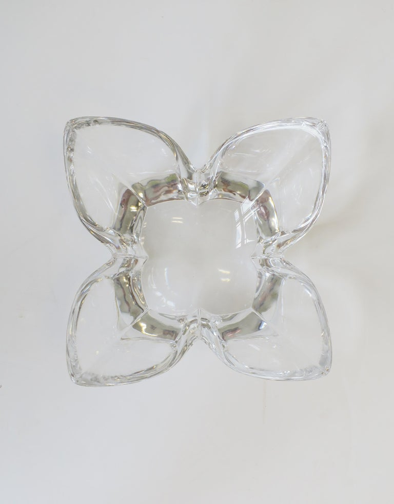 A beautiful Scandinavian Modern or organic modern crystal lotus flower bowl by sculptor/designer Lars Hellsten, circa late 20th century, Sweden. Great as a standalone bowl or as vide-poche/catchall. Maker's mark, Orrefors, signed, and numbered on