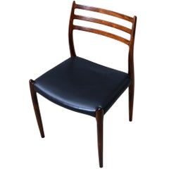 N.O. Moller, 10 Dining Chairs in Rosewood and Black Leather, Scandinavian Modern