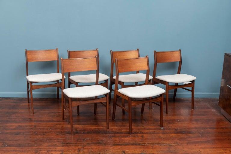 Scandinavian Modern set of six teak dining chairs with newly upholstered Maharam felt seats.