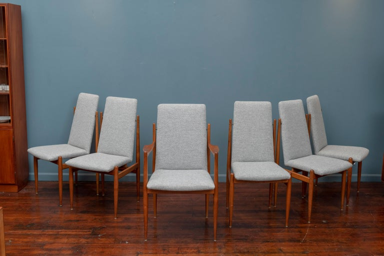 Scandinavian Modern set of teak dining chairs, comprising five side and one armchair. Newly upholstered in Nanna Ditzel design Maharam wool.