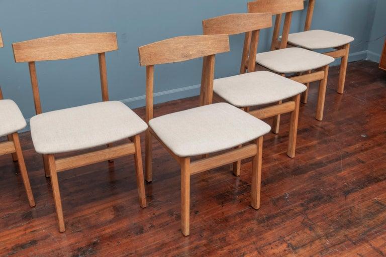 Scandinavian Modern oak dining chairs, Sweden. Interesting Minimalist design with angular details to the frames.
