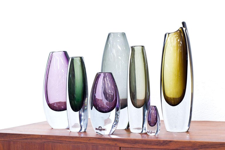 """Group of 7 """"Sommerso"""" vases. Designed by Gunnar Nylund and Asta Strömberg. Manufactured by Strömbergshyttan in Sweden during the 1950s. Coloured glass cased in clear technique. All vases are signed.  Dimensions: H 7 to 27 x W 3.5 to 10 x D 2.5 to"""
