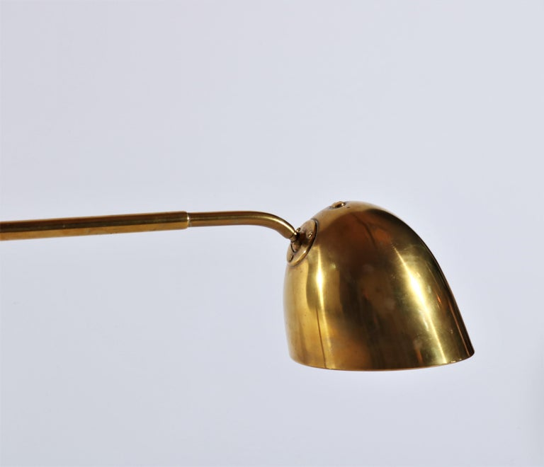 Impressive desk lamp in solid brass with adjustable shades. The lamp is attributed to Danish Architect Vilhelm Lauritzen and was made in the 1940s. Probably manufactured at Louis Poulsen. The lamp has a beautiful patina on the brass and is in great
