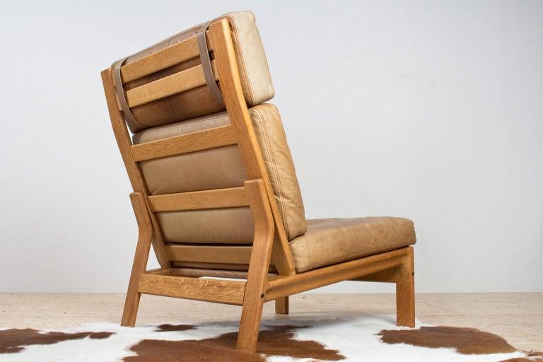 Mid-Century Modern Scandinavian Modern Komfort Lounge Chair in Leather and Oak, 1960s For Sale