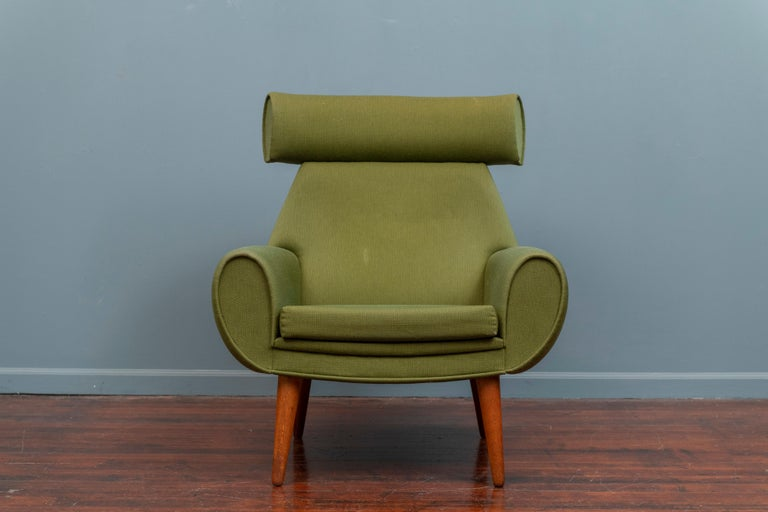 Scandinavian Modern large scale lounge chair, an unusual design by Kurt Ostervig, Denmark.  The lounge chair is ready to use as-is or reupholster it in C.O.M. on tapering oak legs.