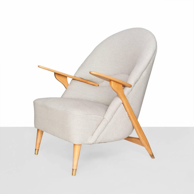 A dramatic Scandinavian Modern Mid-Century armchair with a polished solid beech wood frame by Svante Skogh for Säffle Möbelfabrik. This chair has been completely restored and re-upholstered.