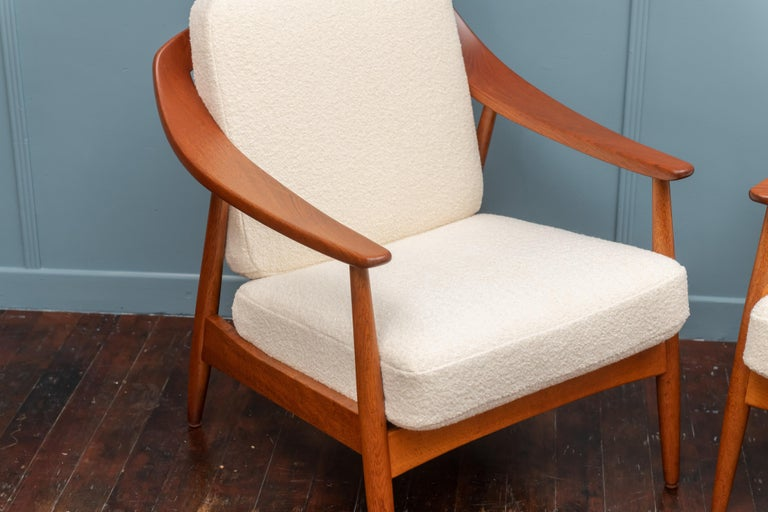 Scandinavian Modern teak lounge chairs newly upholstered and perfectly refinished. High quality construction and attention to design.