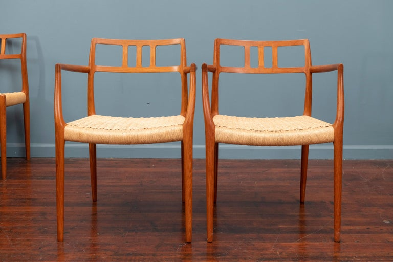 Scandinavian Modern teak dining chairs designed by Niels O. Moller for J.L. Moller, Denmark. Comprising 2 armchairs and 6 sides all frames in very good original condition seats have age appropriate wear and use but still present very well.