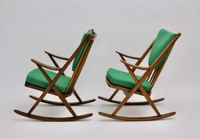 We present a pair of Scandinavian Modern vintage rocking chairs named Gyngestol type no. 182 designed by Frank Reenskaug, circa 1960 and produced by Bramin Mobler, Denmark.