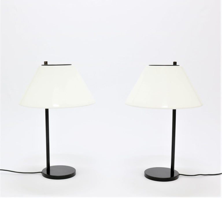 A pair of rarely seen 1960s table lamps by Danish designer Per Iversen. Made and manufactured at Louis Poulsen in 1967. The base is made from lacquered metal and the shade is white acrylic. The lamps are in the style of contemporary Danish designers