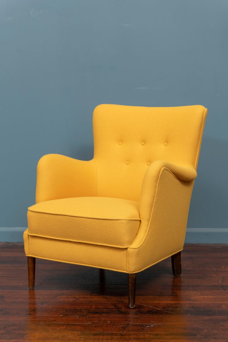 Scandinavian Modern petite lounge chair newly upholstered in a cheerful yellow wool. Super comfy and ready to be enjoyed.
