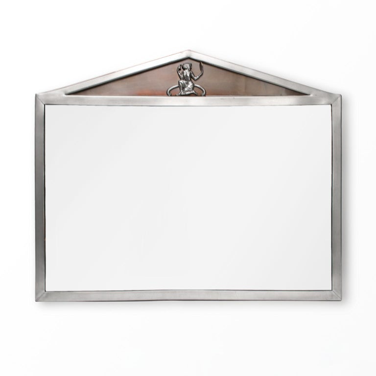 Scandinavian Modern, Swedish Art Deco polished pewter mirror with pediment top which includes a female figure hold a brass mirror. The recessed pediment has a piece of patinated brass. Made by Einar Backstrom, signed on back.  Measures: Height
