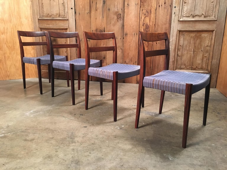 Set of four Mid-Century Modern dining chairs with woven web seats.