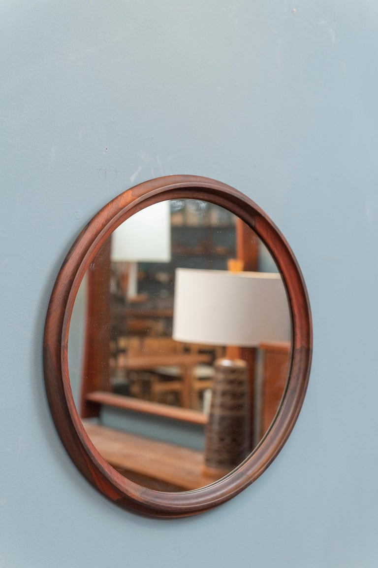 Scandinavian Modern pair of rosewood sculpted edge rosewood wall mirrors, Denmark. High quality construction and attention to design, ready to enjoy.