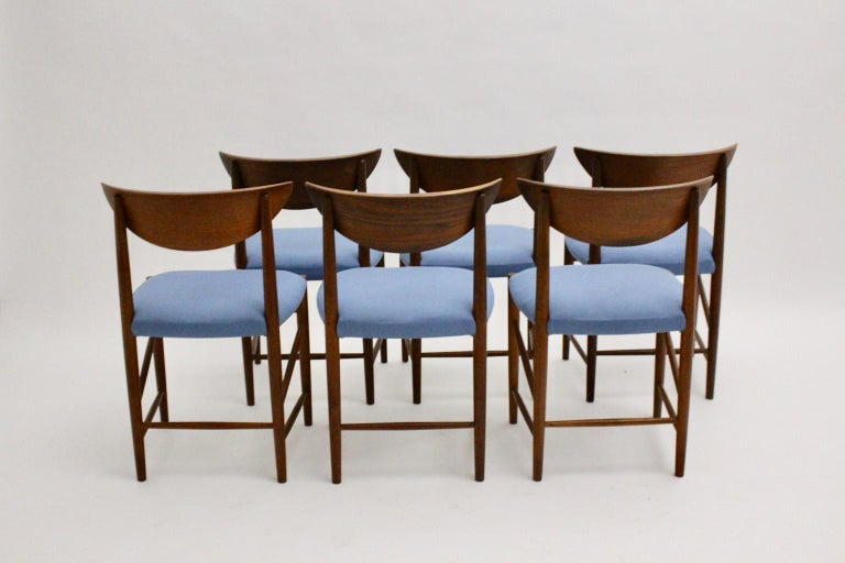 This set of six Scandinavian Modern vintage dining chairs by Peter Hvidt and Orla Moolgard Nielsen were produced by Søborg Mobler DK, circa 1956.