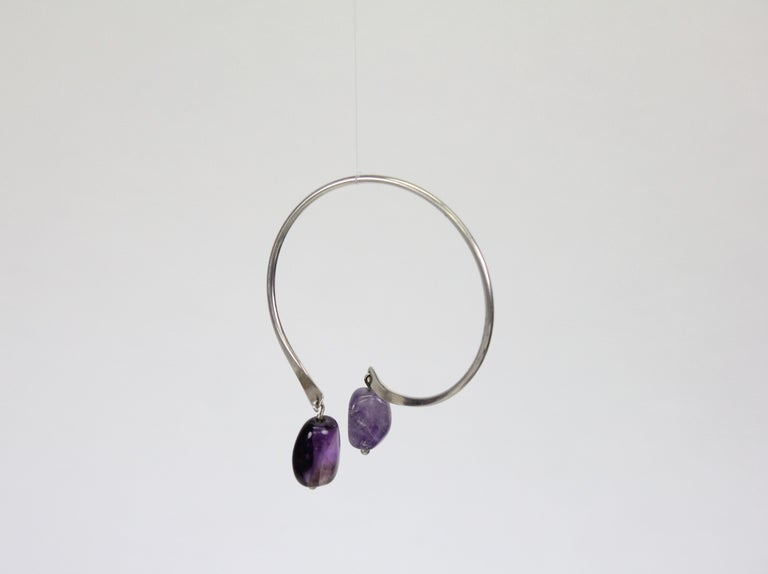 Wonderful bracelet by Swedish Modernist jeweler Borgila in Stockholm. Sterling silver and with two hanging tumbled amethysts.  This bracelet can be worn in different ways, see images.   Fully marked with Swedish silver stamps. Diameter circa 6.5cm