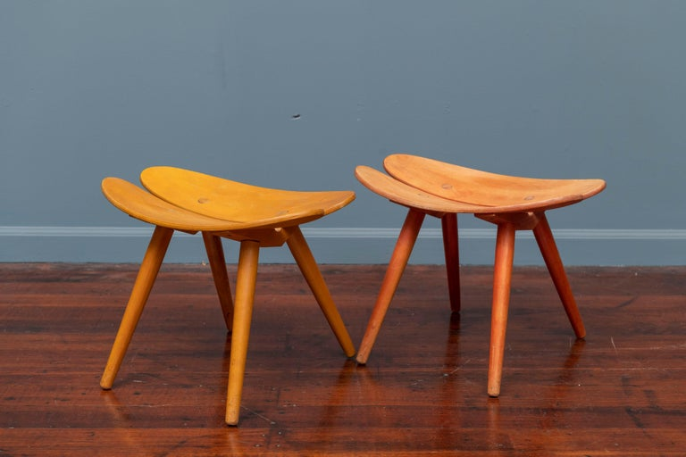 Scandinavian stools in anodized yellow and red with slight color fade consistent with age and use.