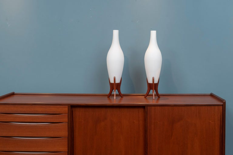 Scandinavian Modern frosted glass and teak table lamps, Sweden. Tall and elegant design lamps that put out a wonderful soft glowing light in very good original condition.